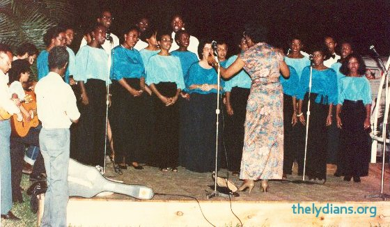 Alma Pierre conducting the Lydians at one of its community performances.